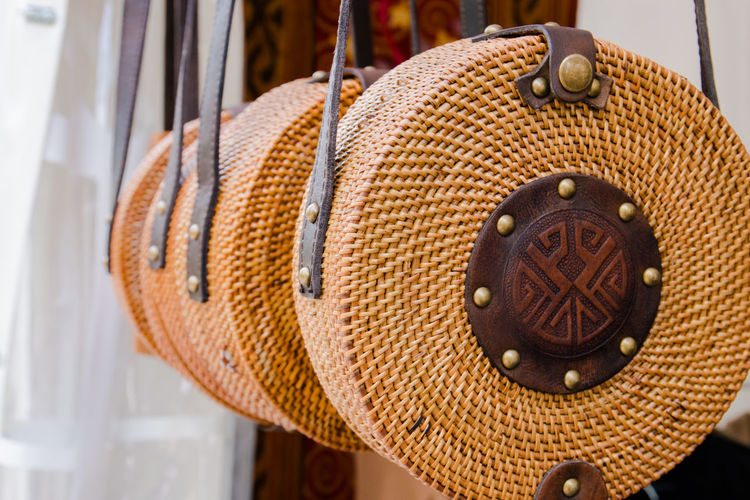 Rattang bags hanging Brown Circle Close-up Clothing Day Focus On Foreground Geometric Shape Hanging Hat Metal No People Orange Color Outdoors Pattern Red Shape Still Life Travel