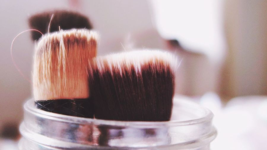 Close-Up Of Make-Up Brushes On Table
