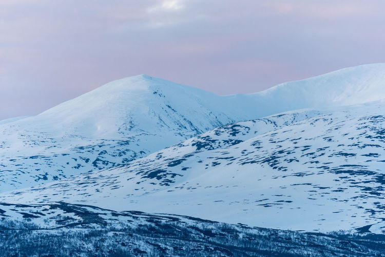 Mountains under the midnight sun 1 Abisko Beauty In Nature Cold Temperature Day Landscape Midnight Sun Mountain Mountain Range Nature No People Outdoors Scenics Sky Snow Snowcapped Mountain Sweden Tranquil Scene Tranquility Weather Winter