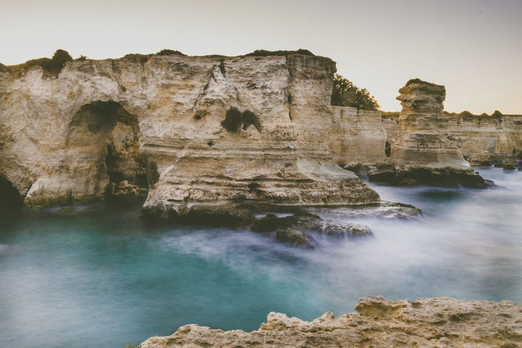 Beach Beauty In Nature Day Italy Natural Arch Nature No People Outdoors Rock - Object Rock Formation Salento Salento Puglia Scenics Sea Sky Torre Sant'andrea Tourism Destination Tranquility Travel Travel Destinations Water Waves Waves, Ocean, Nature