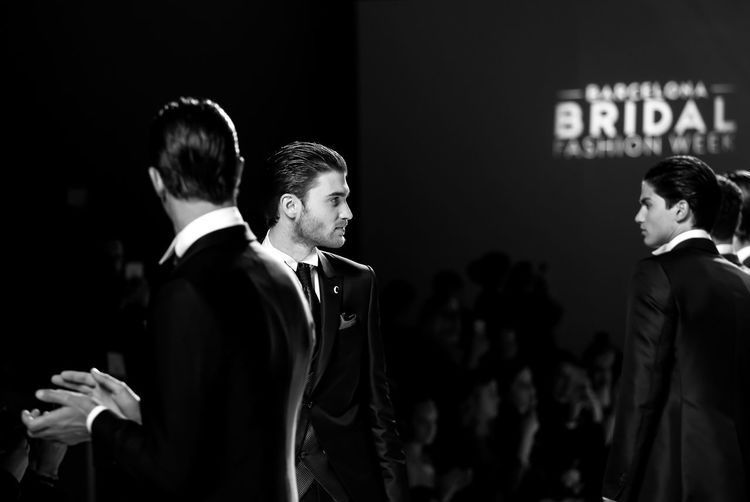 Barcelona Bridal Fashion Week 2017 Bridal Fashion Week 2017 Brides Adult Adults Only Alta Costura Catwalkfashion Communication Event Illuminated Indoors  Men Men Models Model Night Novias One Person Pasarelas People Ramon Sanjurjo Real People Side View Standing Suit Togetherness Well-dressed