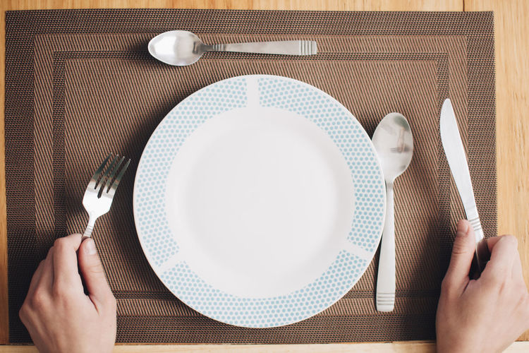 Kitchen Utensil Human Hand Food And Drink Eating Utensil Food Fork One Person Plate Table Directly Above Indoors  Meal Spoon Empty Plate High Angle View Breakfast Hand Table Knife