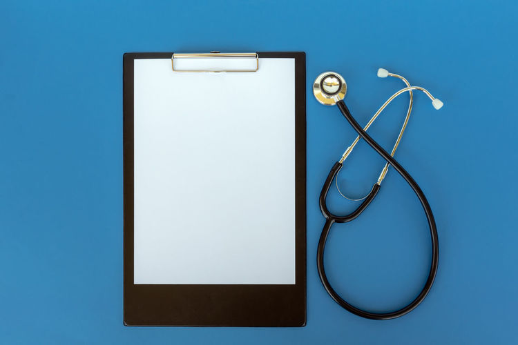 Blue Copy Space Blue Background Studio Shot Still Life Stethoscope  Clipboard Hospital Doctor  Medical Equipment Medical Instrument Healthcare And Medicine Copy Space