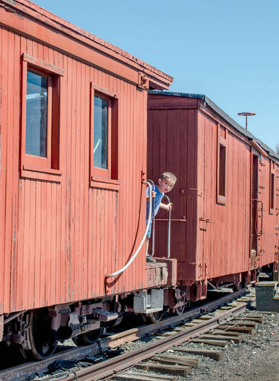 a cute little boy peeks out of a box car he was exploring at a train museum in Colorado caboose box cars large metal technology safety outdoors train station train museum Colorado USAtrip america colorado train Museum editorial education Railway Lines history editorial photography train - vehicle Train Tracks child childhood Fun explore hispanic Imigration Dreamers Caboose Box Cars Large Metal Technology Safety Outdoors Train Station Train Museum Colorado USAtrip America Colorado Train Museum Editorial  Education Railway Lines History Editorial Photography Train - Vehicle Train Tracks Child Childhood Fun Explore Transportation Rail Transportation Railroad Track Stories From The City The Traveler - 2018 EyeEm Awards