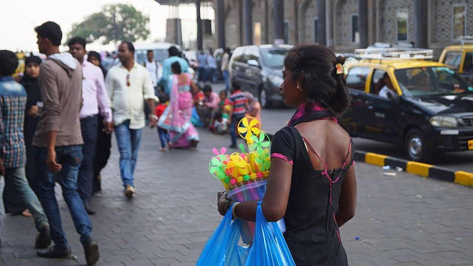 The Street Photographer - 2017 EyeEm Awards Toys Street People Focus On Foreground City Life Rear View Arts Culture And Entertainment (null)Outdoors Women City Colaba Mumbai India Real People