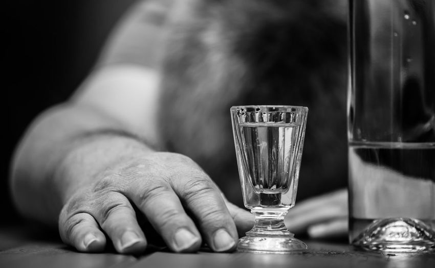 Close-up of man hand by drink