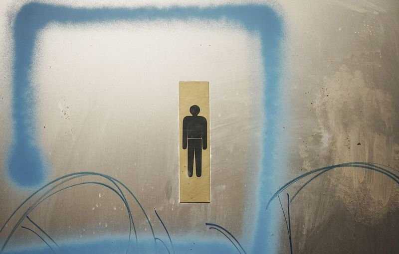 Male restroom sign on door