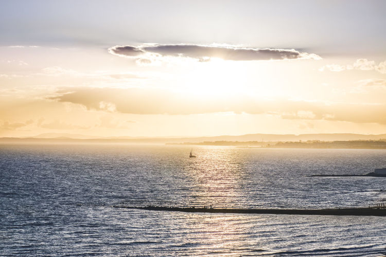 Magical sunset over the Mediterranean Sea. Sailboat in the sun Sky Sunset Water Scenics - Nature Marbella Mediterranean  Sun Tranquil Scene Tranquility Idyllic Horizon Over Water Bright Reflection Sunlight Beauty In Nature Cloud - Sky Nature Sea No People Horizon Sailboat