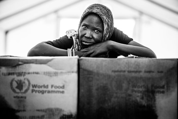 portrait wfp World food programme Aid sadness Sadness And Sorrow food distribution aid package somewhere in Africa The Week on Portrait Wfp World Food Programme Aid Sadness Sadness And Sorrow Food Distribution Aid Package Somewhere In Africa Blackandwhite Bnw Portrait Need Help Refugees Refugee Real World Don't Look Back Poor  Social Issues Development Assistance Food Aid Camp Documentary Reportage