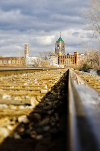 tilt shift detroit Tilt-shift Tilt Shift Tiltshift Detroit Railroad Track Low Angle View Skyline Cityscape Leading Lines Wutang NeverBoilBacon ThereIsNoSpoon Wethepeople TikkunOlam Puremichigan Water City Bridge - Man Made Structure Sky Cloud - Sky Architecture Office Building A New Perspective On Life