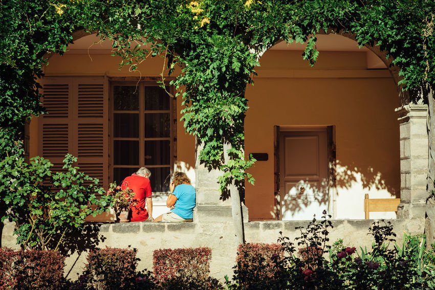 Couple Couple - Relationship Togetherness Together Real People Senior Adult Date Romance Romantic Love Dating Plant Architecture Built Structure Building Exterior Nature Building Growth Lifestyles Day Tree Women Two People Outdoors Window Potted Plant Adult House People Leisure Activity