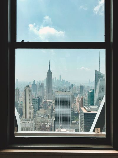 Film Photography Natural Light Windows Window View Empire State Building Built Structure Architecture Building Exterior Sky Building Window City Tower Cloud - Sky Transparent Glass - Material Cityscape Skyscraper Office Building Exterior Tall - High Day Travel Destinations