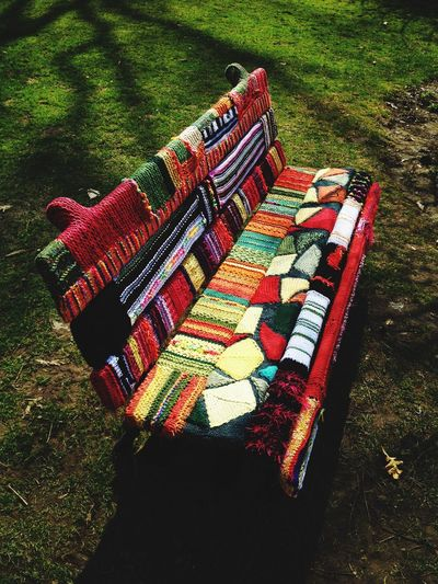 Hell Yes! Super cozy bench nestled within the gardens. Brilliant Bench Upstate NY Yarn Bombing