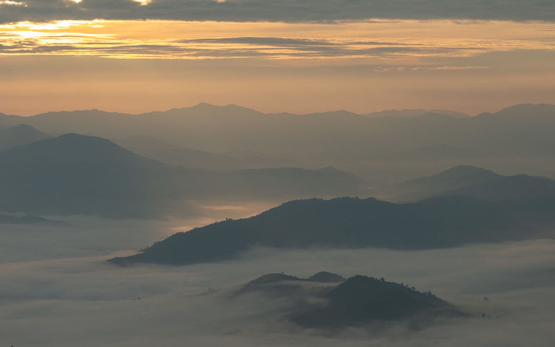 Scenic View Of Mountains And Cloudscape During Sunset