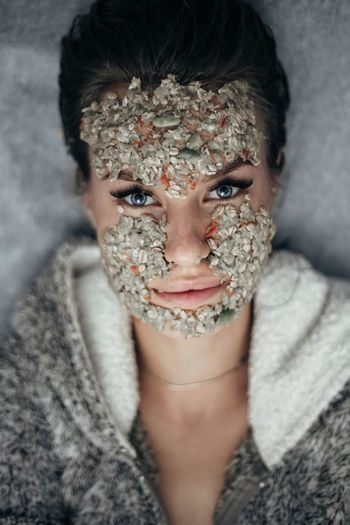 Close-Up Portrait Of Young Woman Wearing Facial Mask