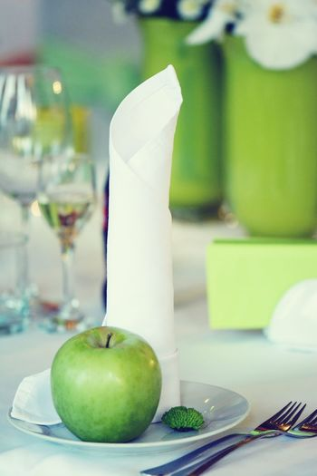 Close-up of granny smith apple in plate on table