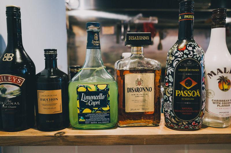 Various bottles on display at market stall