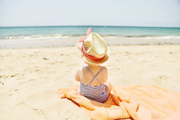 Rear View Of Child On Beach