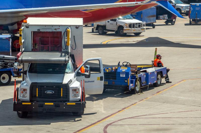 People working on airport runway