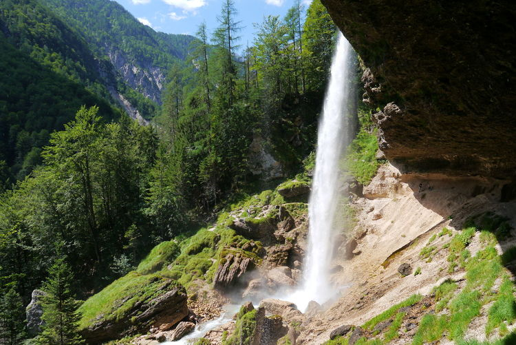 Scenic view waterfall at kranjska gora