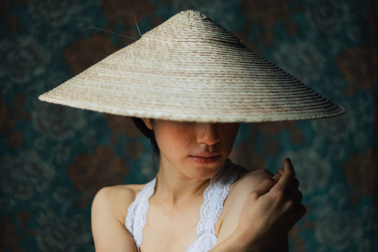 Helúe and the hat in the afertoon. Adult Beautiful Woman Casual Clothing Close-up Clothing Contemplation Day Focus On Foreground Front View Hat Headshot Leisure Activity Lifestyles Looking Looking Down Obscured Face One Person Outdoors Portrait Real People Women Young Adult