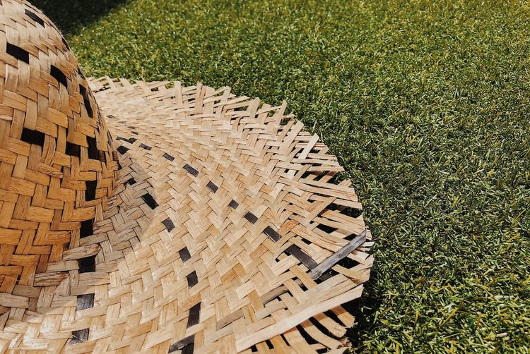 High angle view of straw hat on grass