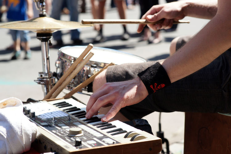 Cropped Image Of Street Musician Playing Music