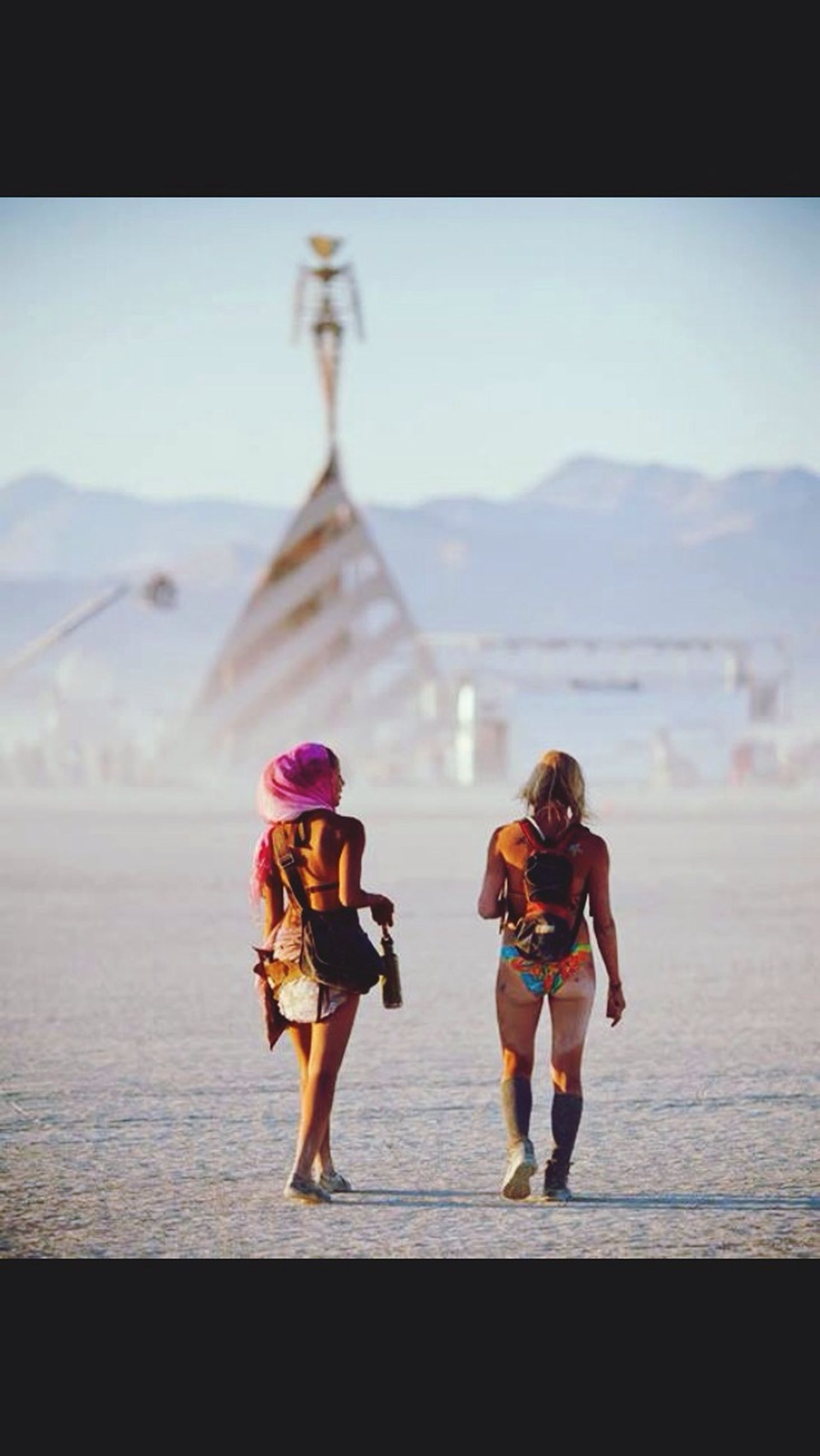 lifestyles, rear view, full length, person, leisure activity, men, transfer print, walking, auto post production filter, tourism, casual clothing, travel, tourist, large group of people, togetherness, sky, standing, travel destinations