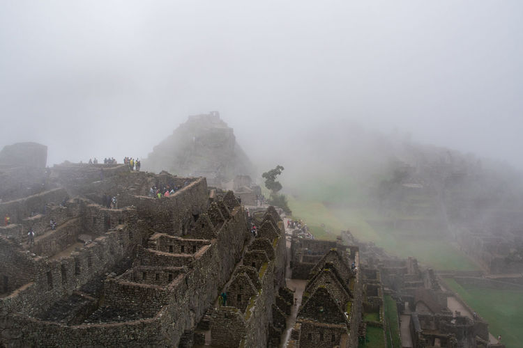 Fog Architecture History Nature Built Structure Building Exterior Day The Past Sky Ancient Travel Destinations High Angle View Environment No People Outdoors Old Ruin Travel Ancient Civilization Landscape Ruined Machu Picchu Inca