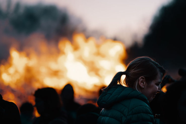 BONFIRE Fire Bonfire Bonfire Night Heat - Temperature Burning Fire - Natural Phenomenon Flame Nature Night Headshot Portrait Orange Color Focus On Foreground People Group Of People Child Real People Leisure Activity Outdoors Women Adult Campfire