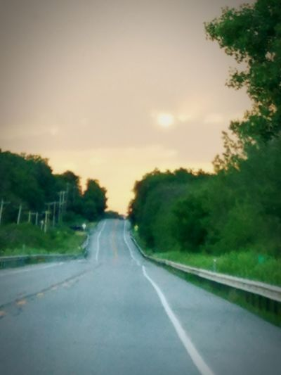 Off into the sunset Road Highway The Way Forward Travel Sunset Tree Rural Scene Nature Asphalt Scenics Cloud - Sky Sky Dividing Line Straight Outdoors Curve No People Landscape Forest Day Sunset Road Endless Road Off Into The Sunset