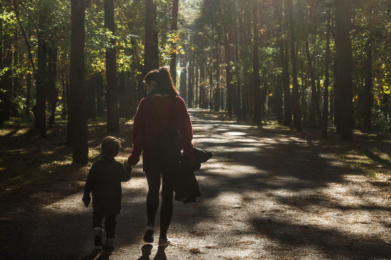 Motherhood Shadows & Lights Child Day Forest Nature Outdoors Park Plant Real People Sun Togetherness Tree Walking First Eyeem Photo