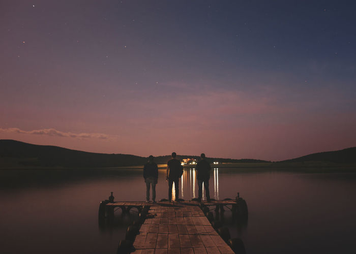 Adult Astronomy Beauty In Nature Camera - Photographic Equipment Constellation Full Length Galaxy Lake Milky Way Mountain Nature Night Outdoors People Photographer Photography Themes Scenics Science Sky Space Star - Space Star Field Tripod Two People