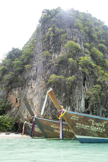 Mountain Nautical Vessel Mode Of Transportation Transportation Water Nature Scenics - Nature Day Beauty In Nature Tree Land Longtail Boat Mountain Range Rock Plant Sky Non-urban Scene No People Rock - Object Outdoors Formation Thailand