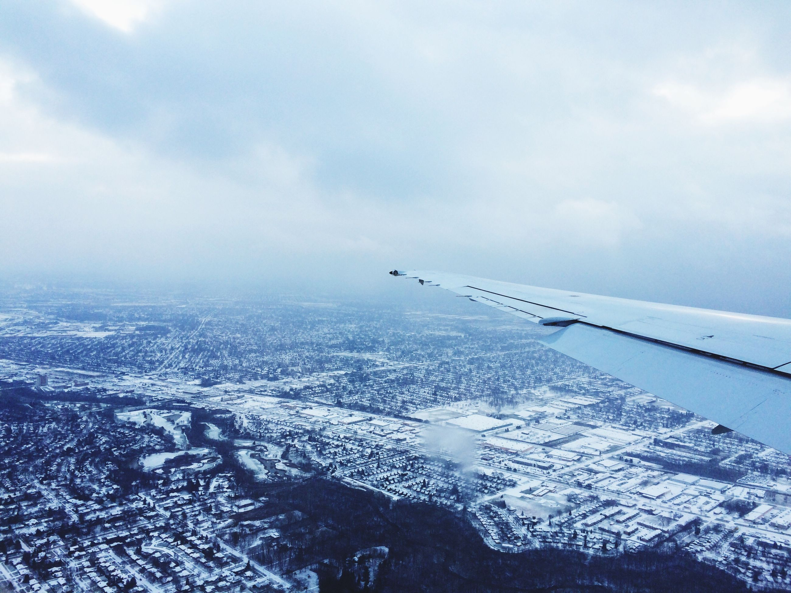 flying, airplane, air vehicle, aerial view, aircraft wing, sky, transportation, mid-air, winter, snow, mode of transport, landscape, nature, cloud - sky, scenics, cold temperature, beauty in nature, public transportation, weather, tranquil scene