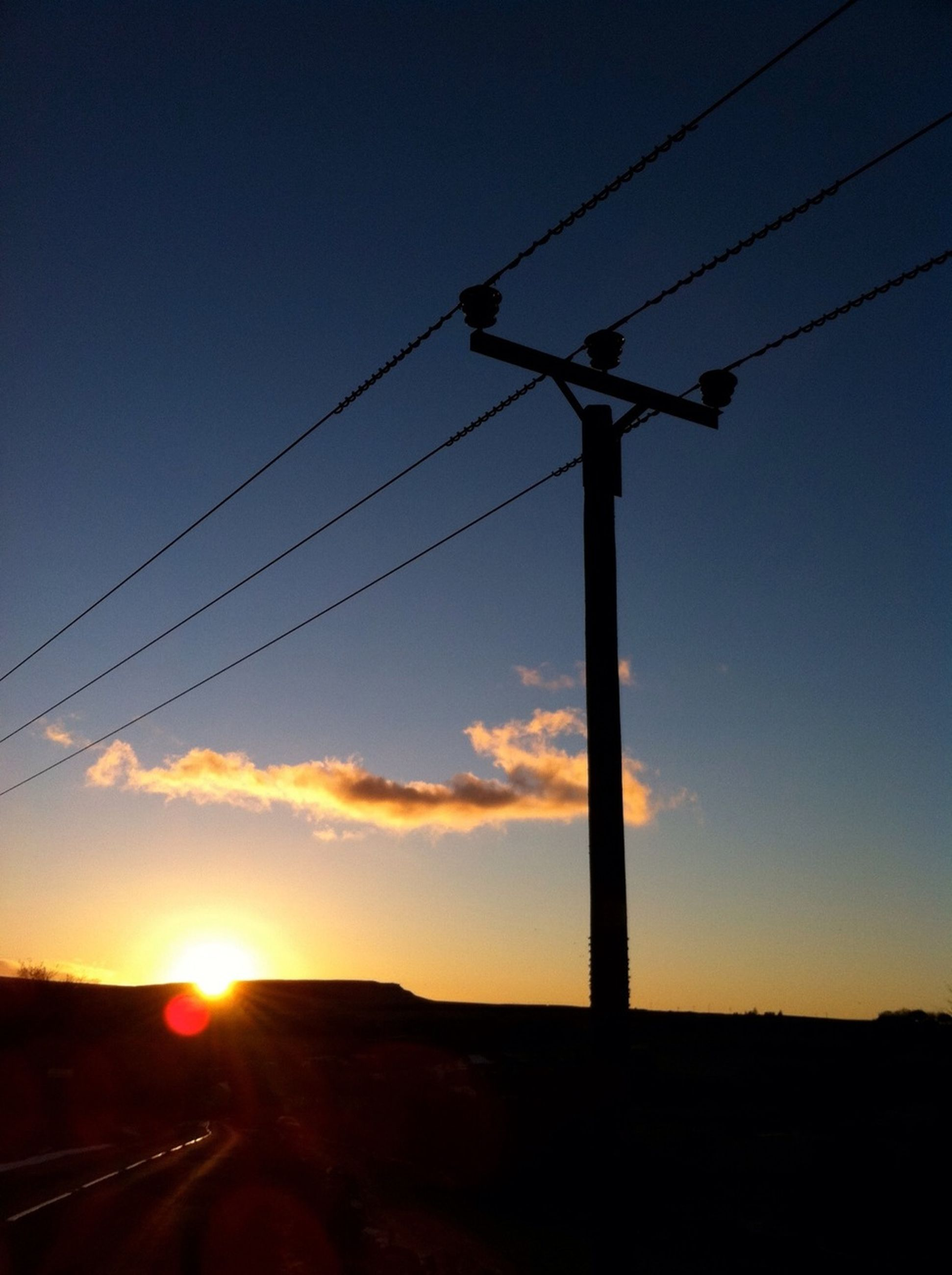 sunset, power line, electricity, silhouette, electricity pylon, power supply, cable, fuel and power generation, sky, connection, technology, sun, power cable, transportation, street light, low angle view, orange color, tranquility, nature, sunlight