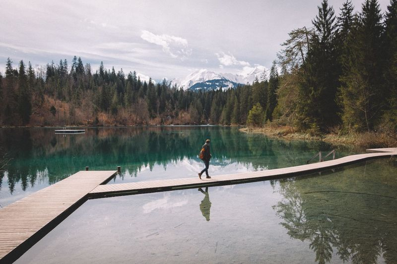 Person walking on pier at caumasee lake