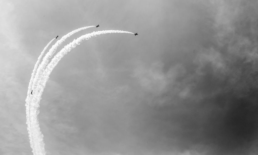 Cloud - Sky Flying Sky Airplane Airshow Air Vehicle Vapor Trail on the move Transportation Plane Low Angle View Motion Fighter Plane No People Mode Of Transportation Smoke - Physical Structure Mid-air Day Nature Travel Outdoors Teamwork Aerobatics Blackandwhite Black And White Black & White Skyporn Skyporn Competition Clouds Clouds And Sky