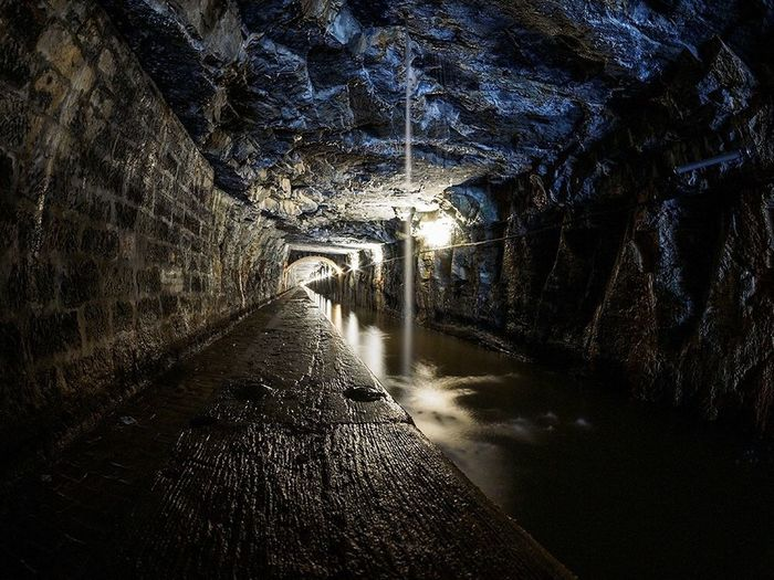 The 631 Mtr Falkirk tunnel carves it's way through solid rock to allow the Union canal to pass through higher ground near Hallglen, Falkirk. Tunnel Falkirk Canal Union Unioncanal Scotland Rock Light And Shadow Light Darkness And Light Dark Lightattheendofthetunnel