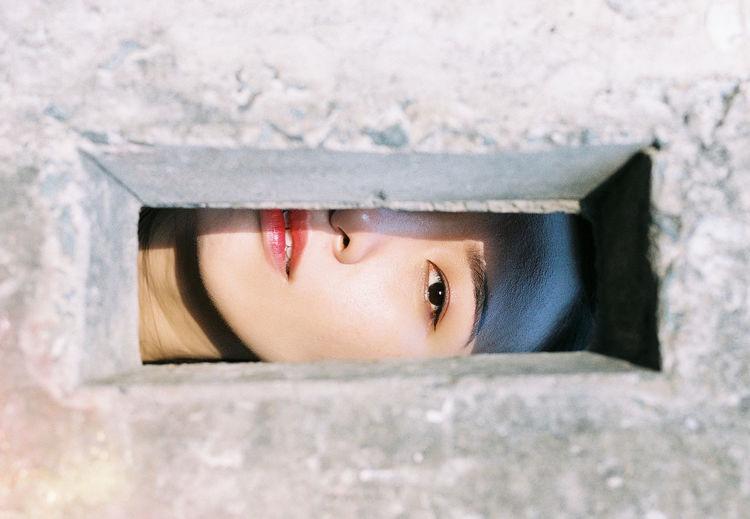 Close-up portrait of cute boy peeking
