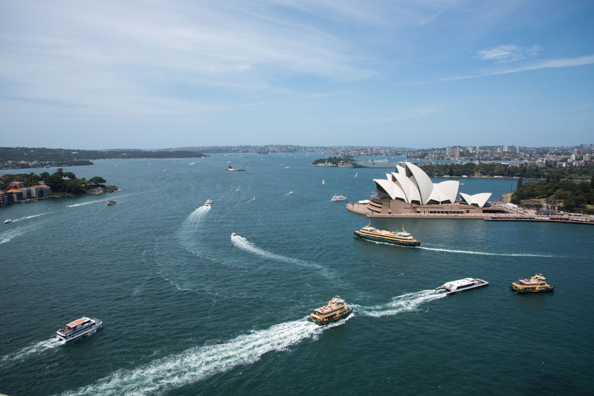 Sydney,NSW,Australia-November 20,2016: Elevated view over the Sydney Opera House at Bennelong Point in Sydney, Australia 20th Century Architecture Australia Cityscape Harbour Roof Sydney Cove Sydney Opera House Tourist Tourist Attraction  Transportation Venue Arts Culture And Entertainment Bennelong Point Boat Building Exterior Elevated View Expressionist Landmark Motion Nautical Vessel Sydney Travel Destinations Wake Water The Week On EyeEm