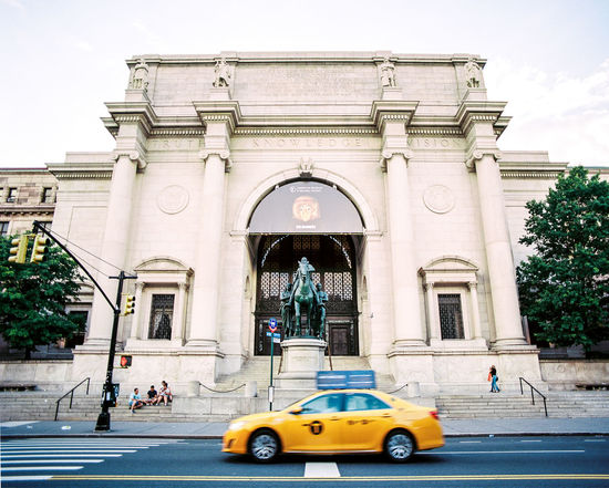 Upper West Side American Museum Of Natural History Architecture Built Structure Building Exterior Mode Of Transportation Arch City Transportation Car Motor Vehicle Day Street Nature Group Of People Building Incidental People Travel Real People Travel Destinations Yellow Sky Outdoors