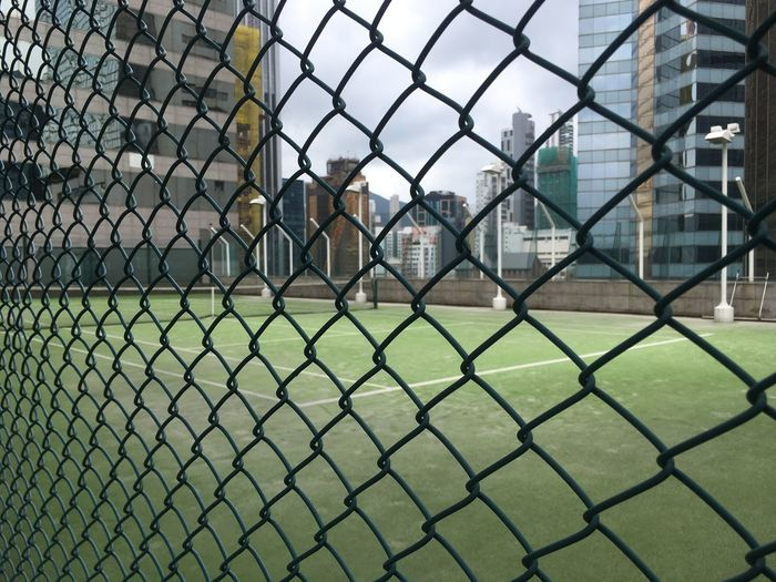 Architecture Building Exterior Chainlink Fence Close-up Day Goal Post Grass Green Color No People Outdoors Playing Field Protection Safety Sky Soccer Field Sport