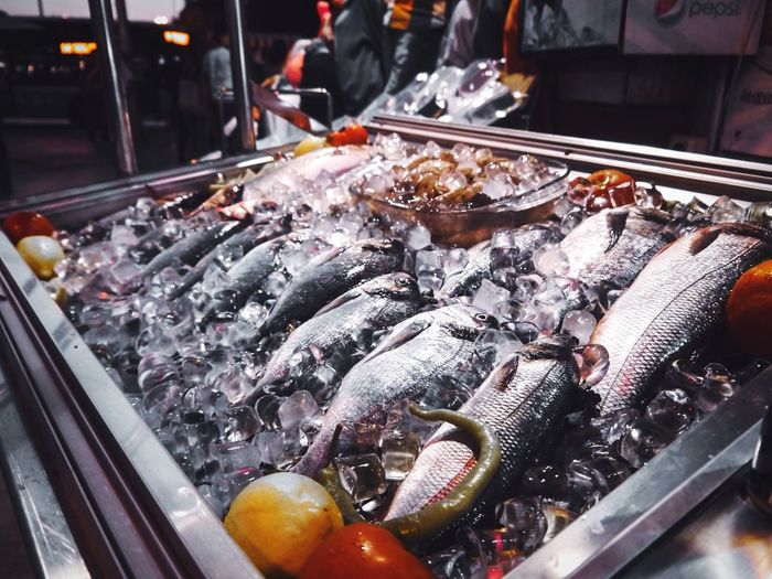 High Angle View Of Fishes With Ice In Store