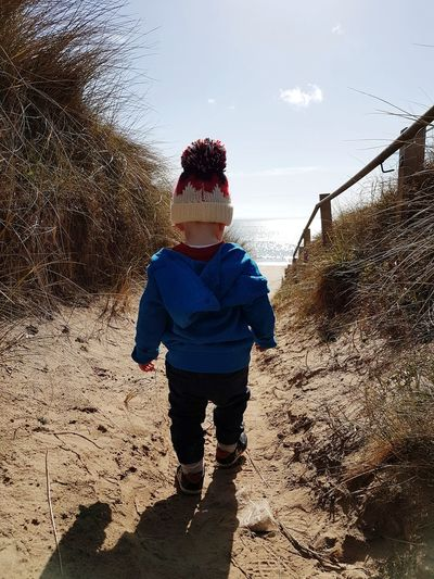 Escape to the Beach Beach Path Beach Boy Happy Fun Family Bobblehat Fresh Sea Quiet Beach Coast Adventure Exporing Toddler  2 Year Old Headwear Child Childhood Full Length Shadow Standing Boys Sand Sky Knit Hat Wave Shore
