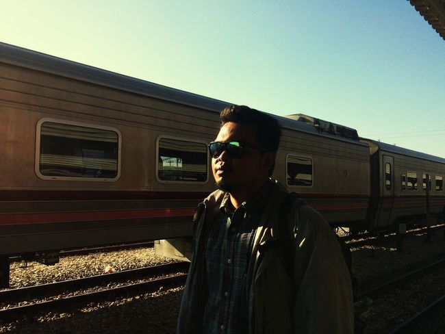 Real People One Person Clear Sky Transportation Rail Transportation Lifestyles Train - Vehicle People Standing