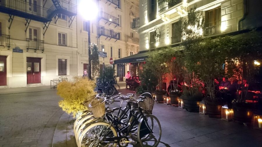 Bicycles. Bicycle Bicycles Paris France France 🇫🇷 Streets Of Paris City Lights Night Lights Restaurant City Life Urban Beauty City Illuminated Flower Architecture Building Exterior Built Structure