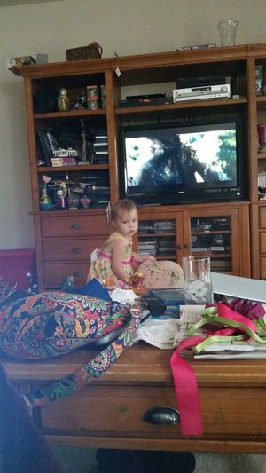 She wants to sit right in front of the tv to watch The Hobbit. Toddlers  The Hobbit Littlesister Movietime