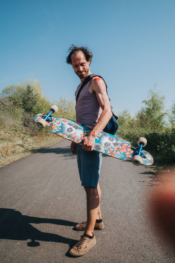 Man with abrasion on shoulder and arm after skateboard accident