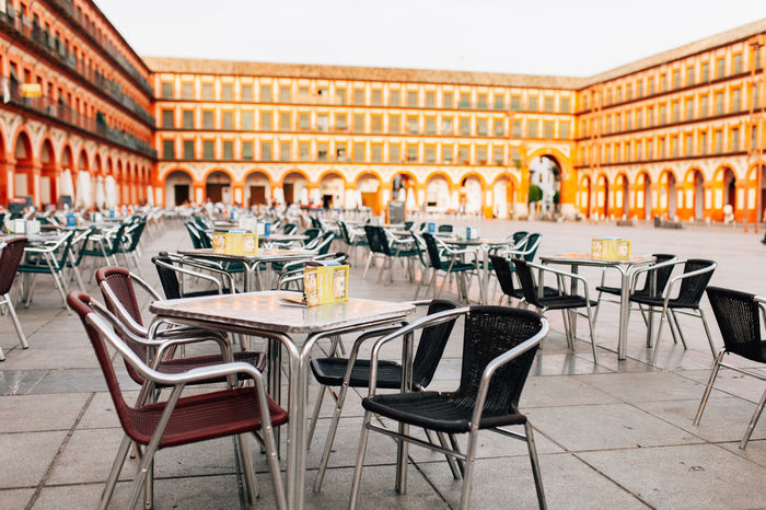 Cordoba, Andalucia, Spain Andalucía Andalusia Architecture Arrangement Beer Chair Chair Coffee Time Cordoba Spain Córdoba Day Empty No People Outdoors Plaza SPAIN Table Terrace Yellow Neighborhood Map Stories From The City